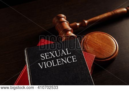Sexual Violence Concept. Wooden Gavel On The Big Red Book. Juridical Protection.