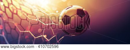 Soccer ball in the net in the sunbeams. Golden background