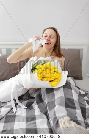 Allergy Medical Seasonal Flowers Concept. Woman With Napkin Fighting Blossom Allergy On Bed At Home.