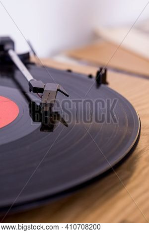 Retro Player With A Vinyl Disk On Blurred Background.old Gramophone Turntable With Disc.playing Viny