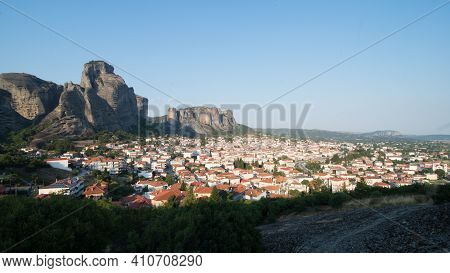 View Of Kalambaka City, Greece, With Meteora Mountains In The Background