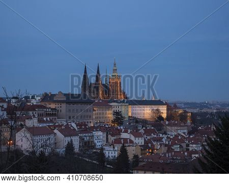 Evening View Of Illuminated St. Vitus Cathedral Gothic Churche And Prague Castle Panorama, Hradcany