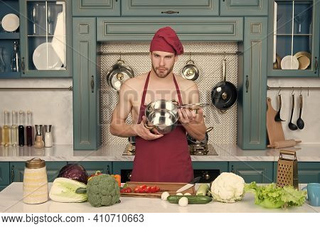Sexy Man Preparing Vegetables. Dinner In Pot. Eco-friendly Products For Cooking. Ingredients For Veg