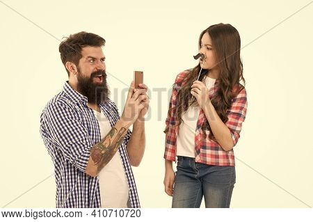 Take Photo. Creative Team. Bearded Man Take Photo Of Small Child. Girl Posing With Mustache Props. H