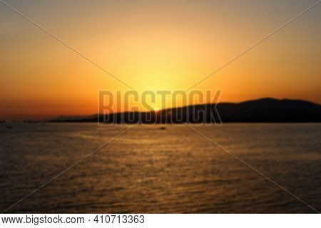 Defocused Bright Orange Sunset In A Clear Sky Over The Sea In The Resort Town Of Gelendzhik. The Sun