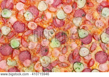 Background Texture Of Pizza With Pickles Salami And Sausages