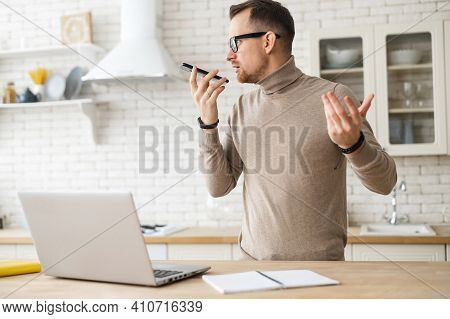 Portrait Of Successful Boss Talking On Mobile During Job, Freelancer Standing By Table, Talking On P