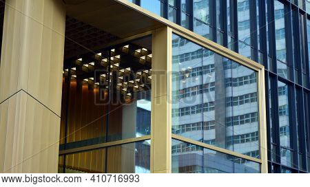 Fragment Of Glass And Metal Facade Walls. Commercial Office Buildings. Abstract Modern Business Arch