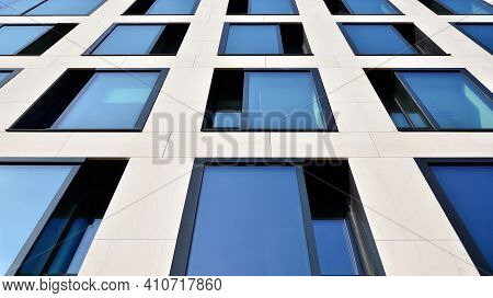 A Fragment Of The Glass And Sandstone Facade Of A Modern Office Building. Wide Abstract Fragment Of