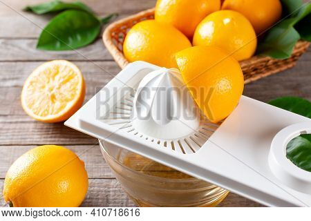 Squeeze Fresh Lemon Juice On Wooden Background