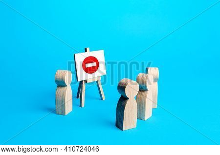 People And Easel With A Prohibition Sign. Restrictions On Rights, Rules Norms. Sanctions. No Entry.
