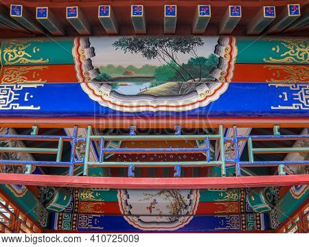 Beijing, China - April 29, 2010: Summer Palace. Closeup Of Painted And Sculpted Wooden Beam Architec