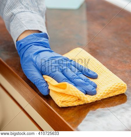 Woman Wiping Table Countertop In Kitchen By Wet Cloth Rag. Female Charwoman Hand Cleaning Disinfect