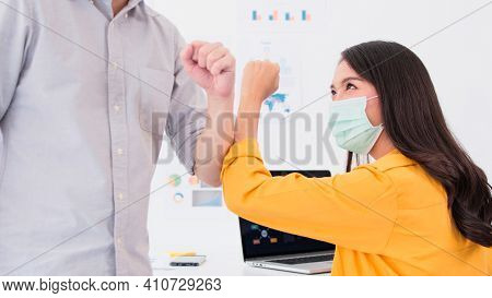 Asian Business Woman Wear Face Mask Using Laptop Computer Work At Home Office, Greeting With Coworke