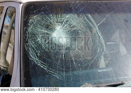 Broken Windshield. A Badly Broken Windshield on an old white panel truck. Broken Windshields are dangerous and illegal to drive with. Window Repair Companies come to you to replace your broken glass.