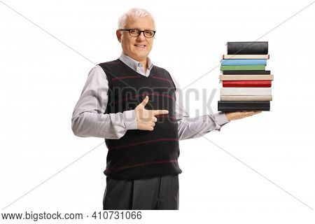 Wise mature man holding a pile of books and pointing isolated on white background