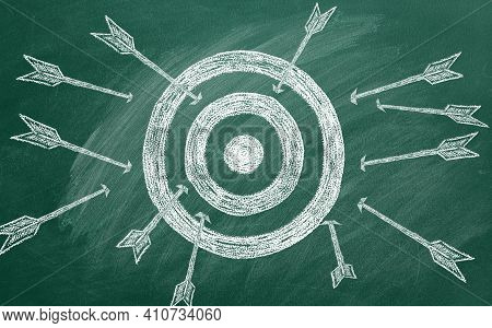 Many Different Arrows And Target Drawn In Chalk On A Blackboard. Concept Of Competition, Strategy, A