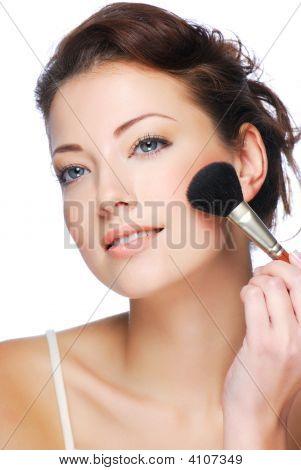 Woman Applying Rouge