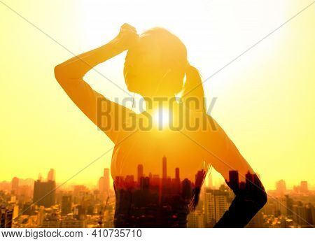 Double Exposure Portrait Of  Young Woman Hand Wiping Sweat With Summer Heat Wave Background