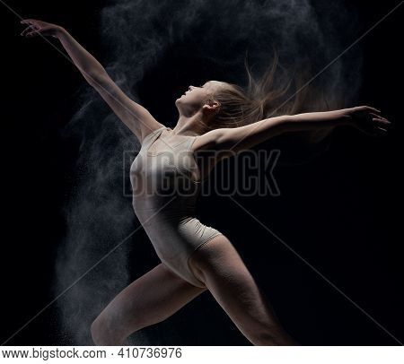 Athletic Dancer In Cloud Of Powder On The Scene