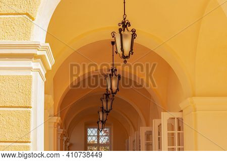 Beautiful sunny arcades with lamps