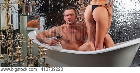 Luxury Lifestyle. Handsome Man With Sexy Girl In Bath. Sexy Couple Bathing. Relationships And Glamou
