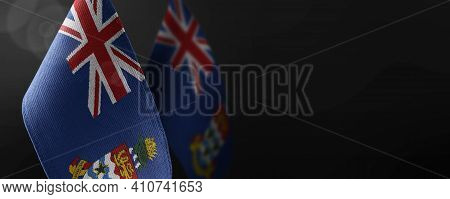 Small National Flags Of The Cayman Islands On A Dark Background