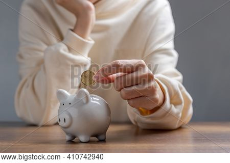 Woman Hand Putting Money Coin Into Piggy For Saving Money,   Wealth Financial, Saving Money For Fina