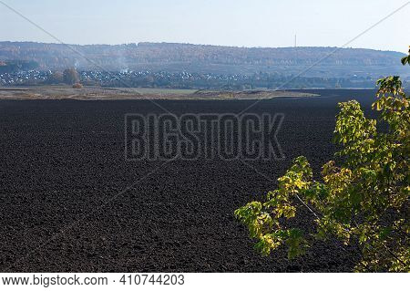 A Plowed Field After Harvesting Grown Crops. Free Ground For Planting Crops. Agricultural Business.