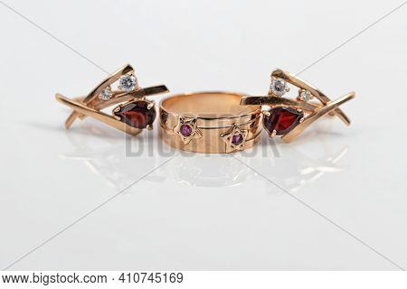 Gold Ring With Ruby Inserts In The Shape Of Stars And Ruby Earrings