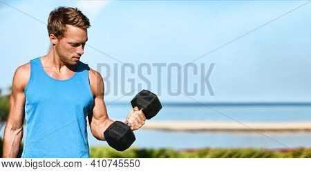 Fitness exercise fit man working out training muscles at gym doing bicep curls with free weight dumbbell banner.