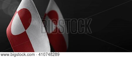 Small National Flags Of The Greenland On A Dark Background