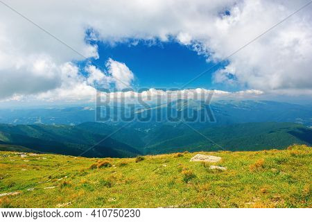 Carpathian Summer Mountain Landscape. Beautiful Countryside With Rocks On The Grassy Hill. View In T