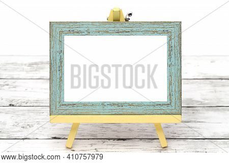 Old Wooden Picture Frame With Easel On Grungy White Table