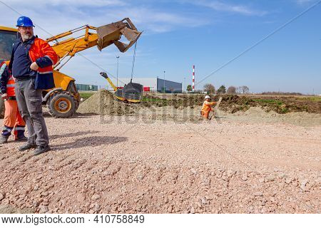 Zrenjanin, Vojvodina, Serbia - March 30, 2018: Excavator Is Carry, Over Building Site With Raised Up