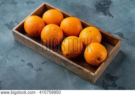 Raw Organic Cara Navel Oranges Set, In Wooden Box, On Gray Stone Background , With Copyspace  And Sp