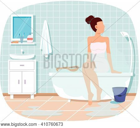 Woman Sitting On Bathtub. Trendy Bathroom Interior Design. Girl Sits Wrapped In Towel After Shower O