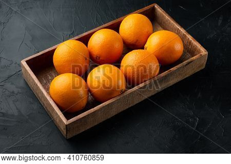 Raw Organic Cara Navel Oranges Set, In Wooden Box, On Black Stone Background , With Copyspace  And S