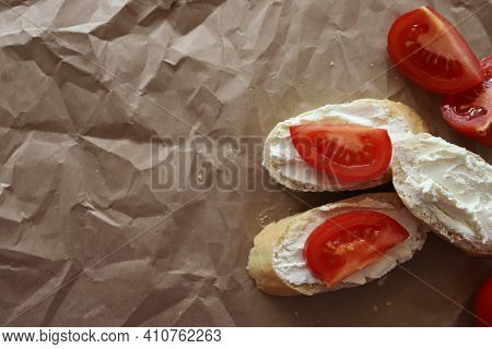 White Bread Sandwiches Smeared With Curd Cheese And Ripe Juicy Tomato. With A Place For Text.