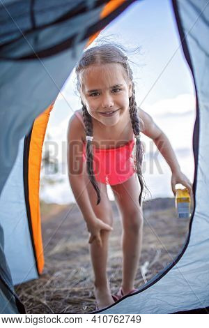 Family Local Getaway. Kid Sitting In The Camping Tent At Campsite And Looking At Sea, Healthy Active