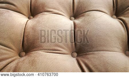 Detail Of Upholstery Of Modern Furniture, Chair, Armchair, Pouf Or Pillow. Carriage Coupler. Brown N
