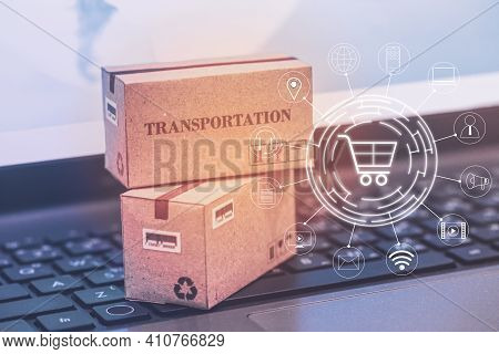 Concept Of Transportation And Online Shopping : Packaging Cardboard Boxes And Notebook Keyboard. Int