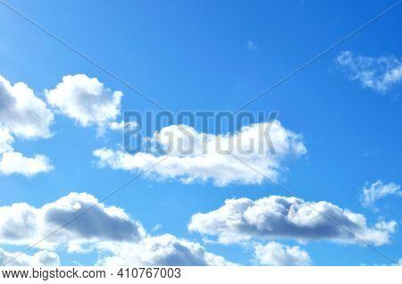 Sky background, sky high scene, big blue sky with fluffy clouds.Vast blue sky, colorful sky landscape, sunny sky nature, blue sky with white clouds. Sky background, sky scene, sky landscape view,vast sky,sky natural view,sky background