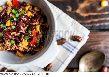 Mexican Chili Or Chilli Con Carne. Cooked Kidney Bean, Minced Meat, Chili, Corn And Pepper In Pan  O