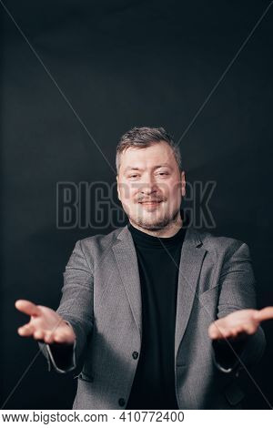 Smiling Cheerful Man Stretching Hands Forward, Smiling And Gazing Camera With Care To Give Hug, Cudd