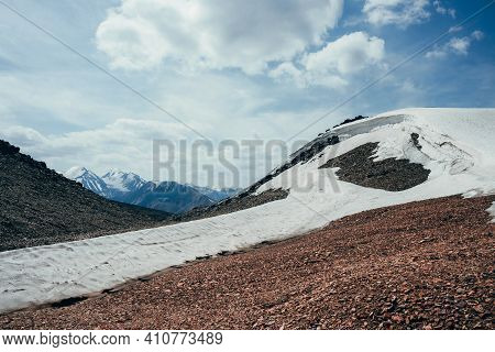 Wonderful View To Small Glacier On Stony Hill Under Blue Sky With Clouds. Surreal Alpine Landscape W