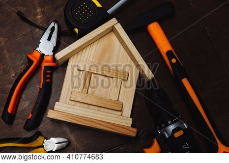 Various Repair Tools And Model Of House. Equipment For Building