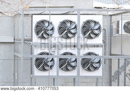 Condenser Side Of A Ductless Split-type Air Conditioner. Air Conditioning Condenser Units Outside A