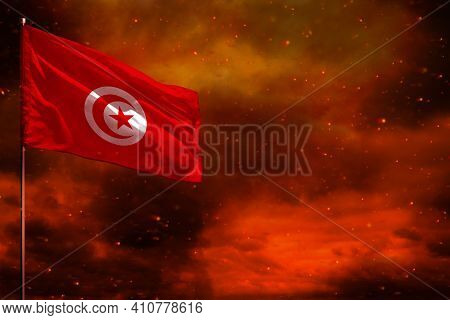 Fluttering Tunisia Flag Mockup With Blank Space For Your Data On Crimson Red Sky With Smoke Pillars
