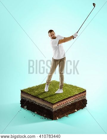 Ready. Golf Sportsman Playing On Blue Background Above Stadium Layers. Professional Player Practicin